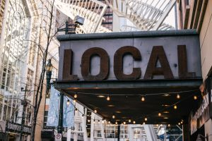 The word local on a sign outside a storefront