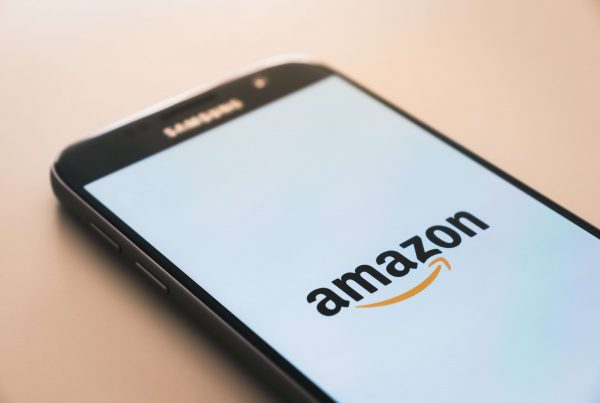 A smartphone with the Amazon app loading