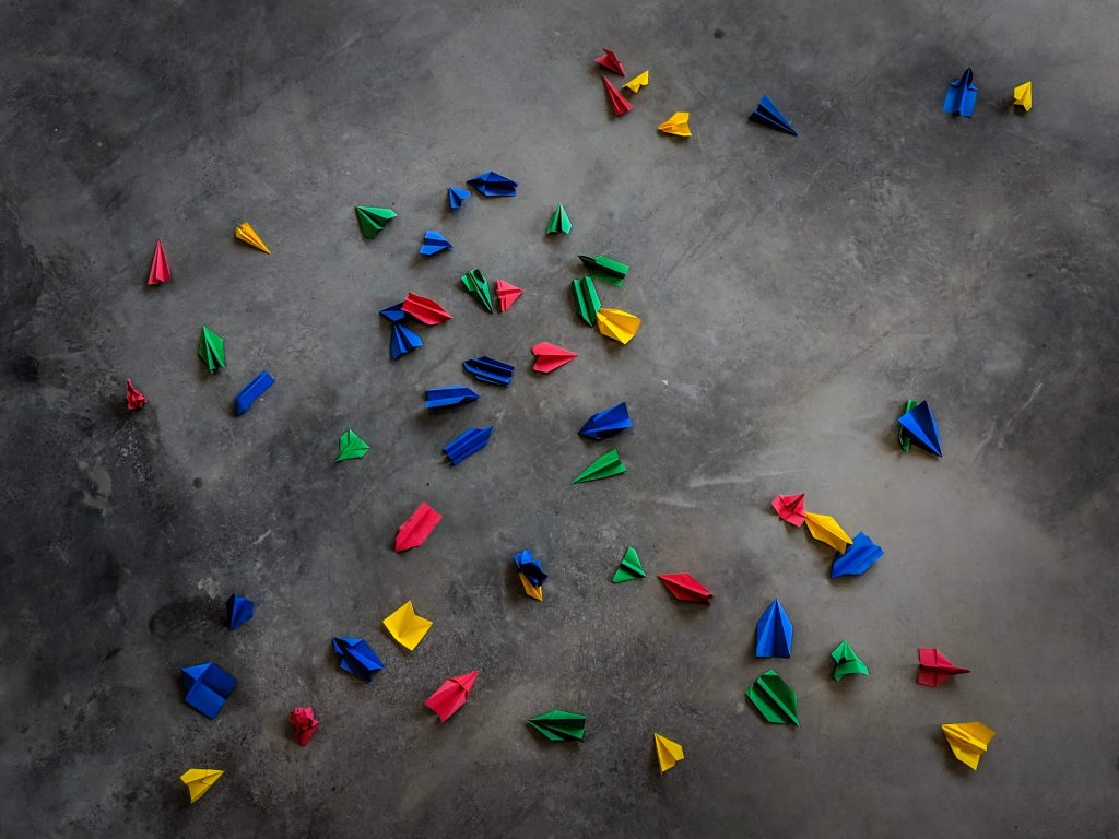Colorful Paper Airplanes scattered randomly on the floor