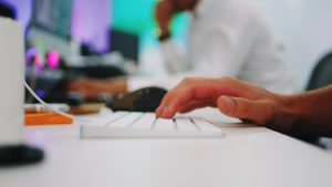 A person typing at their keyboard