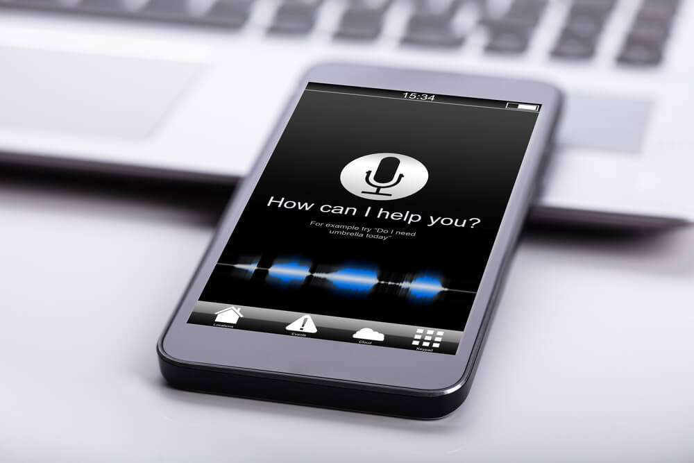 An iPhone with the voice search feature displayed