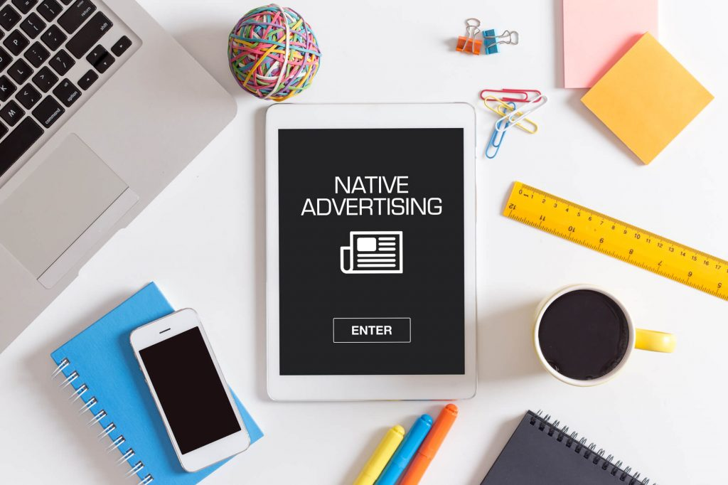 "A tablet that has the words ""native advertising"" on it"