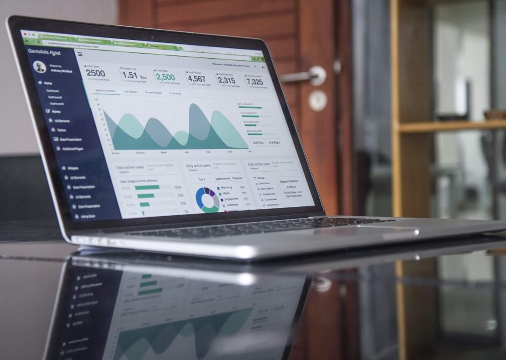 A laptop with a PPC analytics dashboard pulled up