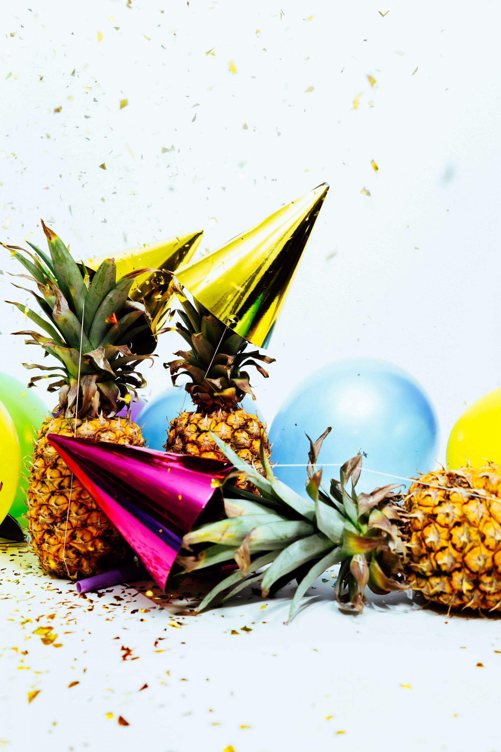 Pineapples, party hats, balloons, and confetti