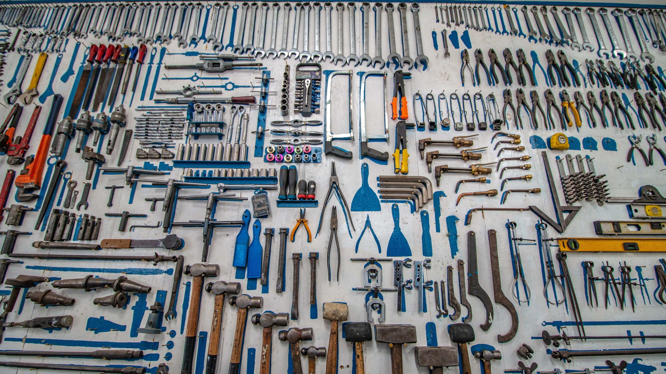 a huge variety of tools on a wall